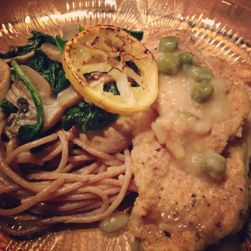 chicken piccata with whole wheat pasta, capers, mushrooms and spinach.
